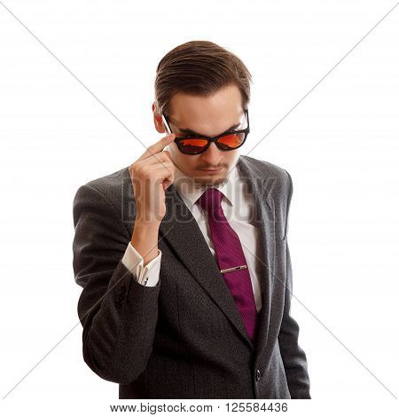 A young well dressed man with sunglasses on white background