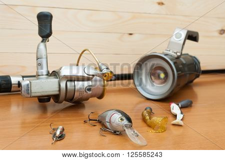 a set of fishing equipment on a wooden background