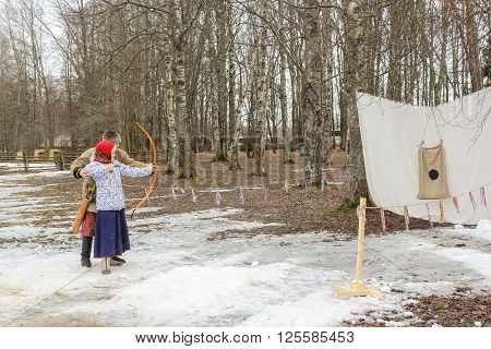 Vitoslavlitsy, Russia - March 12, Competition marksman from onions, March 12, 2016. Holiday Carnival in general Vitoslavlitsy near Novgorod.
