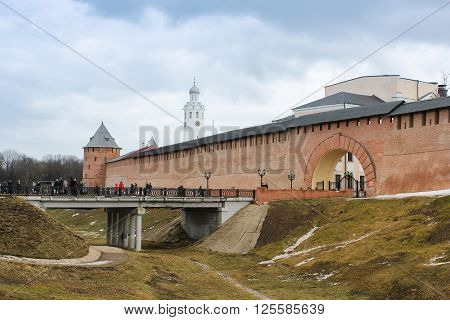 Velikiy Novgorod, Russia - 12 March, People on the bridge to the Kremlin, 12 March, 2016 Types of towers and walls of Kremlin in Veliky Novgorod.