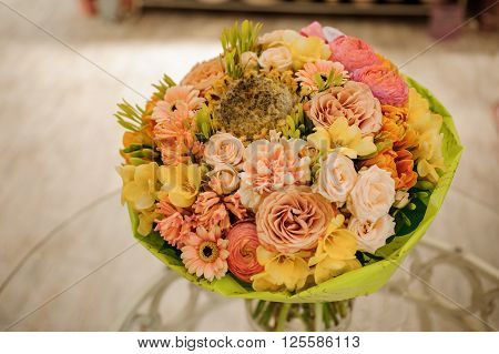 colorful bouquet with roses. flower composition. on table