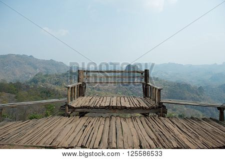 Wooden bench of viewpoint on high mountain