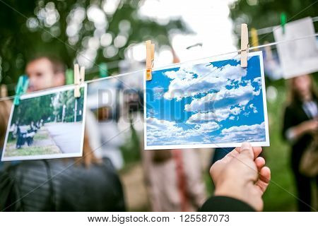 Omsk, Russia - May 21, 2014: Festival of Photography in street, picture sky hanging on a rope