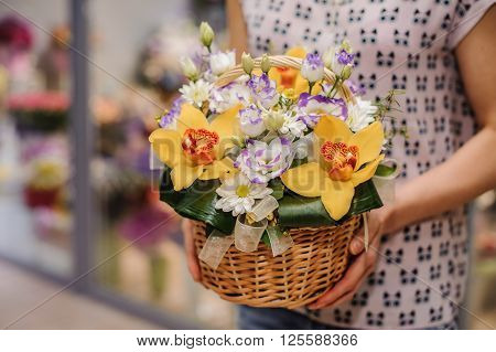 colorful bouquet with different flower composition in hands