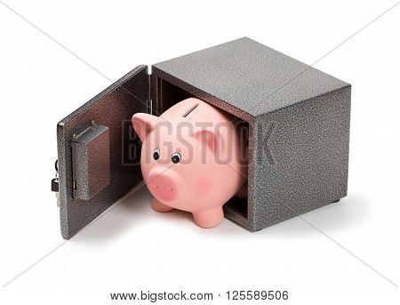 Piggy bank in a safe. Isolated on white