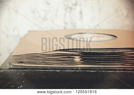 Vintage gramophone records on a stack on top of a record player