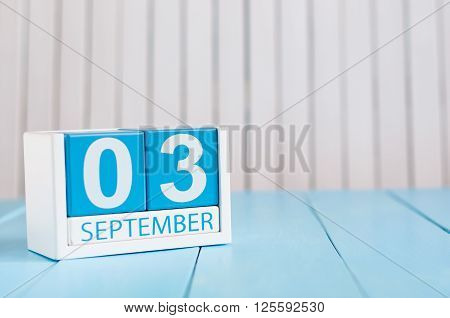 September 3rd. Image of september 3 wooden color calendar on white background. Autumn day. Empty space for text.