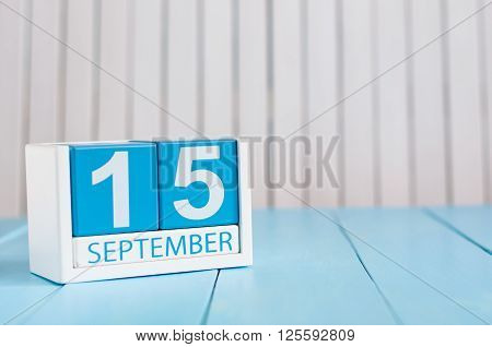 September 15th. Image of september 15 wooden color calendar on white background. Autumn day. Empty space for text.