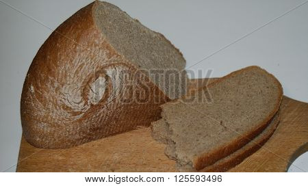 What do You think about bread - and what bread thinks about You? Take, eat; this is My body, which is broken for you. Two slices of bread and a loaf of bread on a cutting Board.