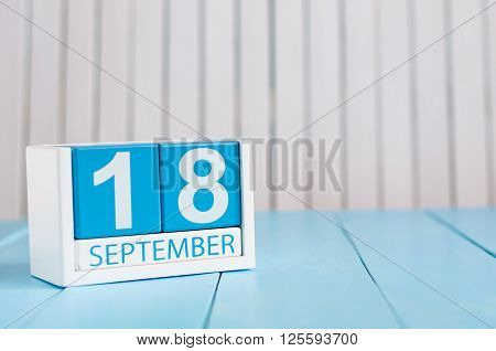 September 18th. Image of september 18 wooden color calendar on white background. Autumn day. Empty space for text.