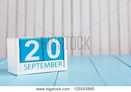 September 20th. Image of september 20 wooden color calendar on white background. Autumn day. Empty space for text.