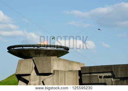 Kites fly over Eternal flame during celebration of Victory Day at the Museum of The History of Ukraine in World War II in Kyiv, Ukraine