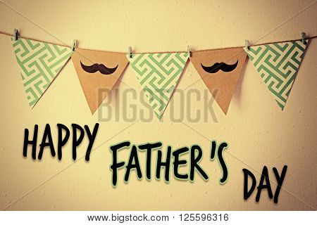 Happy Father's Day. Triangle garland with mustache and pattern hanging on wall