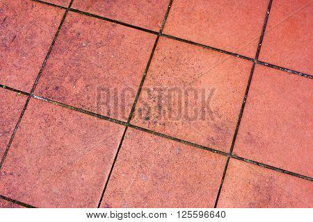 red earthenware tiles in an outdoor floor