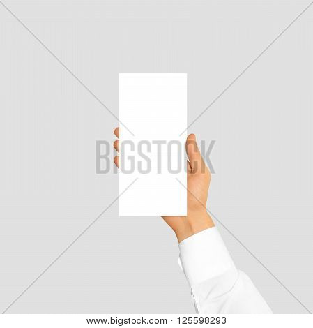 Hand holding blank flyer brochure booklet in the hand. Leaflet presentation. Pamphlet hand businessman. Man show offset paper. Sheet template. Booklet design. Paper sheet display read first person.