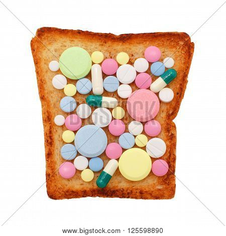 different colored pills on toasted bread. unhealthy eating. Gluten sensitive enteropathy. concept. isolated on white background