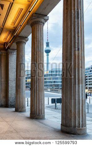 TV Tower on Alexanderplatz in Berlin seen through columns