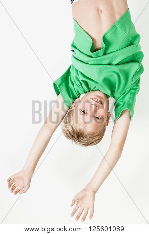 Upside Down Boy In Green Shirt