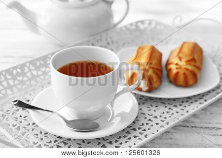 Tea with pastries filled with custard on the tray
