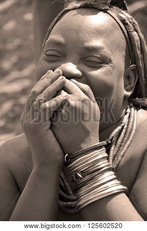KHORIXAS, NAMIBIA OCTOBER 09, 2014: Unidentified woman from Himba tribe. The Himba are indigenous peoples living in northern Namibia, in the Kunene region of South-West Africa on october 09 2014