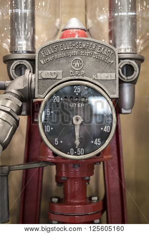 Verona Italy - May 9 2015: Detail of an old manual fuel pump used to refuel cars in the 50's.