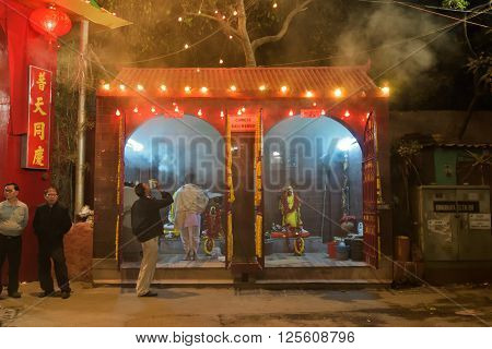 KOLKATA WEST BENGAL INDIA - FEBRUARY 7TH 2016 : Hindu priest praying in front of Chinese Kali statue at famous Chinese Kali temple in Kolkata. Kali is Indian Hindu Goddess as per Hindu myth but worshipped by Chinese of Kolkata also.