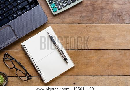 Office stuff with laptop calculate penand leather notebook.Top view with copy space