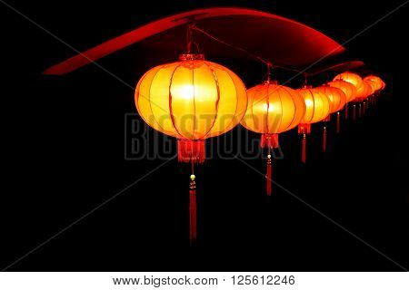 The red lanterns shining into the darkness. The red lanterns you can see all around the China.