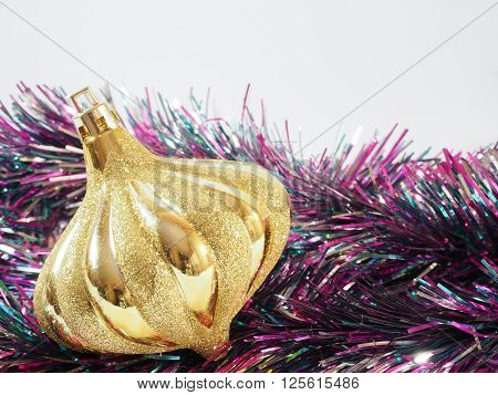 Colorful streamer and golden ball on the background