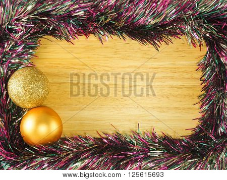 Colorful streamer and golden ball on the wooden board ** Note: Visible grain at 100%, best at smaller sizes