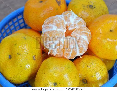 navel orange peel out on blue plastic basket