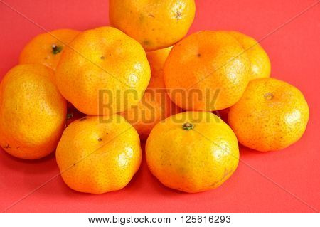 navel orange on red rubber foam board background
