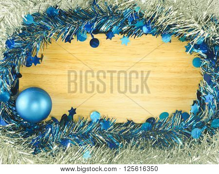 Colorful streamer and blue ball on the wooden board