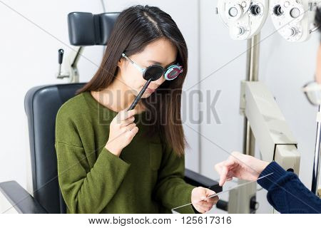Patient during an eye examination at eye clinic