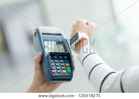 Customer using smart watch for payment