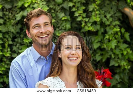 Front view of happy smiling couple at front yard