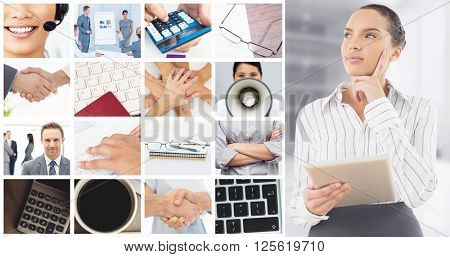 Confused businesswoman using a tablet pc against modern room overlooking city