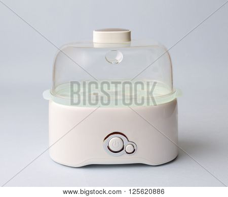the egg cooker on a light background