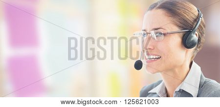 Businesswoman wearing headset against colorful adhesive notes