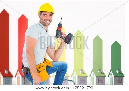 Confident handyman holding power drill while climbing ladder against seven 3d houses representing energy efficiency