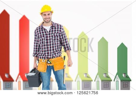 Happy male hanyman carrying toolbox against seven 3d houses representing energy efficiency