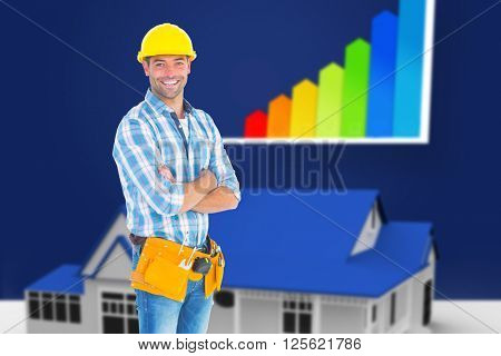 Portrait of manual worker standing arms crossed against blue house standing with energy rating