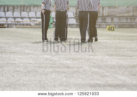 American football referees standing on the field