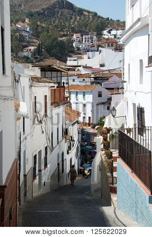 ALORA, SPAIN - JUNE 27, 2008 - Townhouses along a steep old town street Alora Malaga Province Andalusia Spain Western Europe, June 27, 2008.
