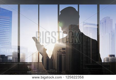 business and people concept - silhouette of businessman with smartphone over double exposure office and city background