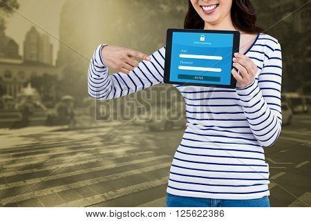 Mid section of woman pointing at tablet computer against picture of a zebra crossing