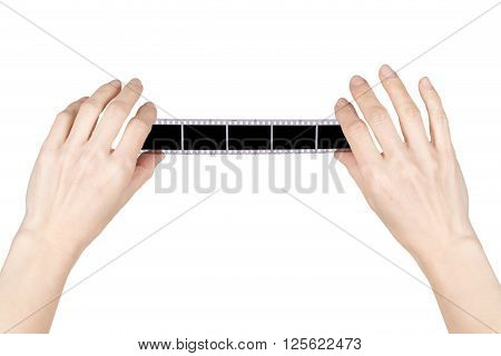 hands holding a negative over white background