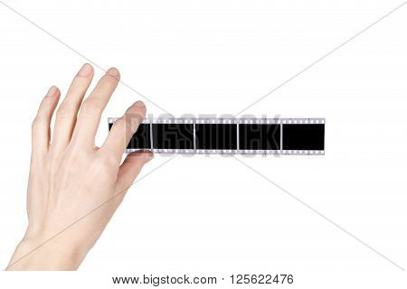 hand holds a negative over white background