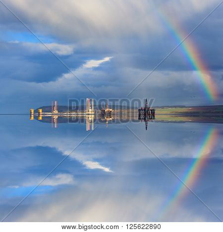 Semi Submersible Oil Rigs and Rainbow with Reflection at Cromarty Firth in Invergordon Scotland