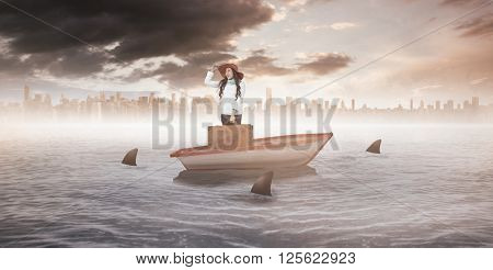 Smiling Asian woman holding luggage holding hat against sharks circling a small boat in the sea